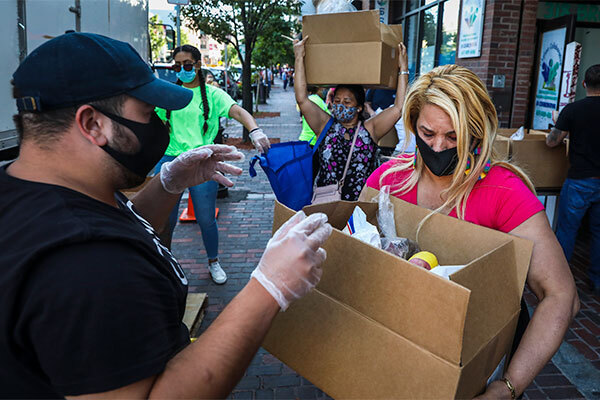 Volunteers hand out food in Chelsea, Mass., in July 2020.